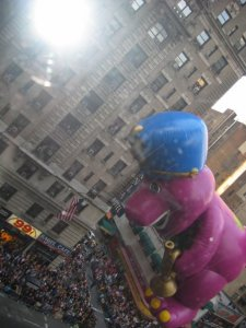 Is it Godzilla stalking Broadway? No, it's just Barney celebrating Thanksgiving.